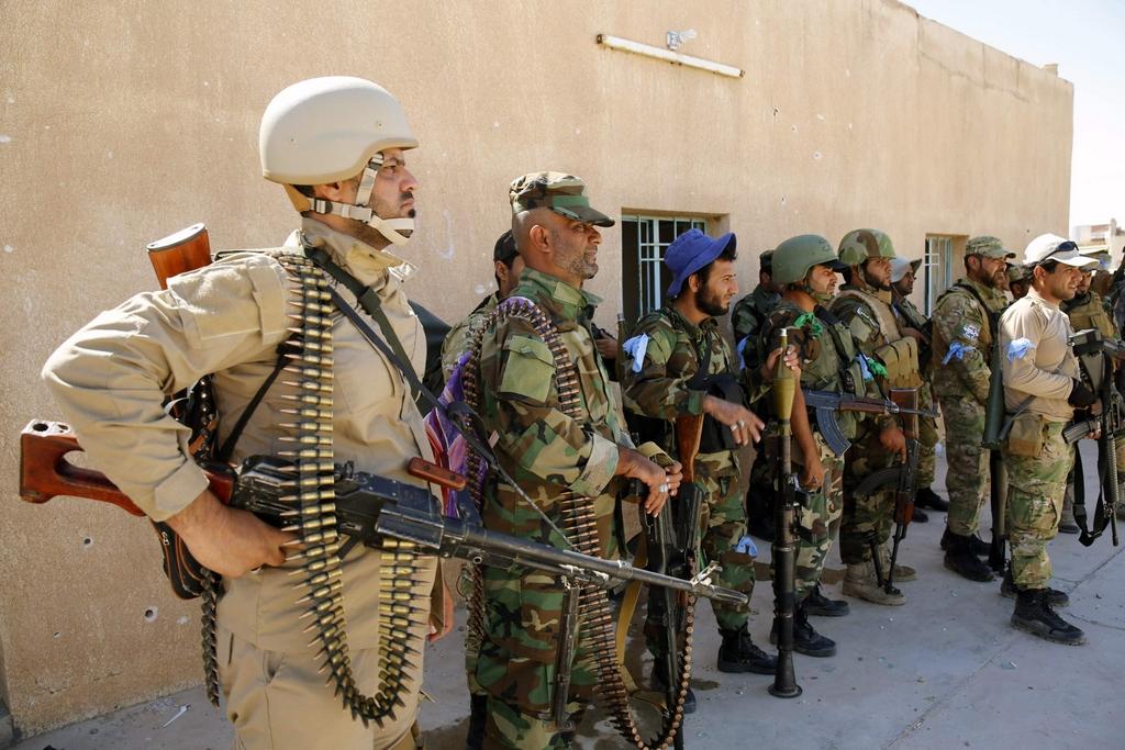 Kurdes, force armée irakienne, milices... Iraq240shox7