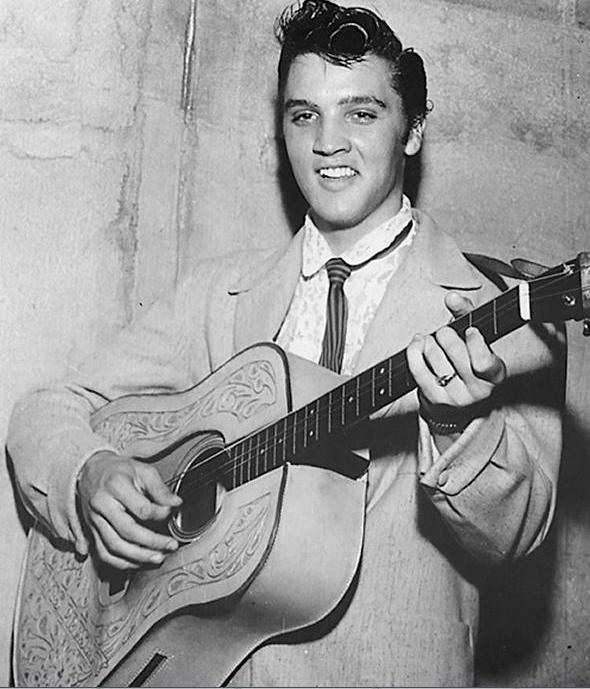 8db7c4453a39 Rumors say that Elvis was backstage mingling with female fans and was late  for his performance and couldn't find in a hurry his guitar.