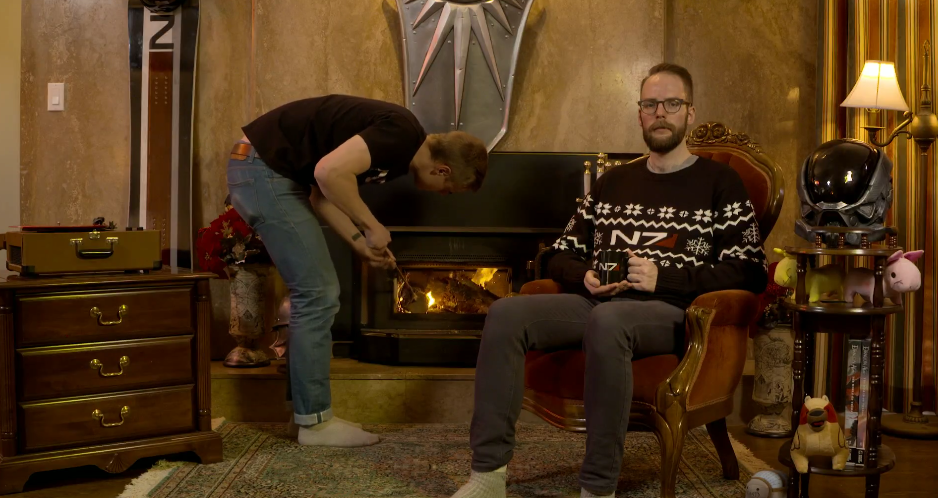 overwatch yule log jeff kaplan sitting in front of a fireplace for